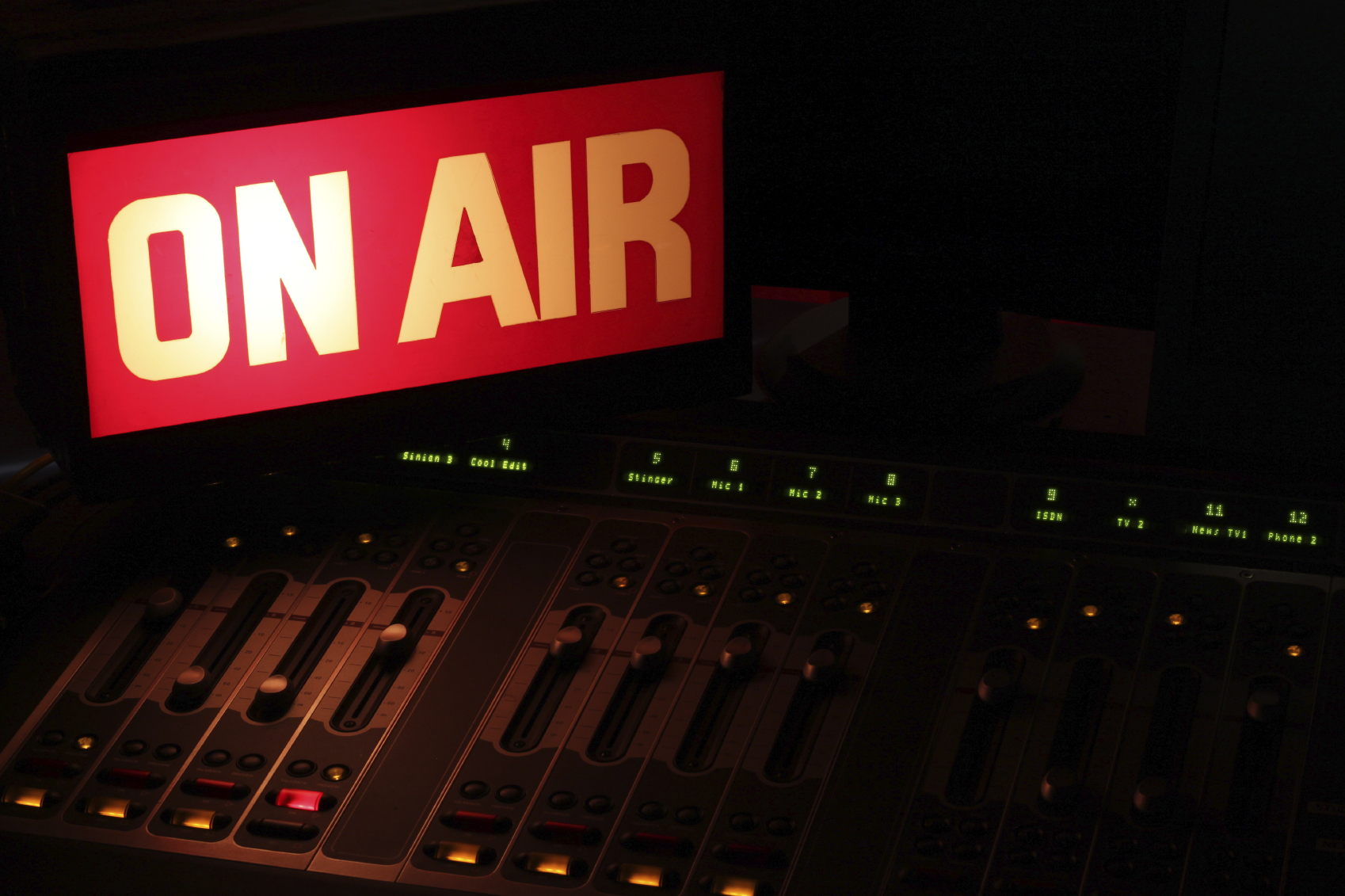 On Air sign in a studio broadcasting via radio, podcast or wireless transmission.